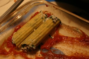 uncooked manicotti shells in the pan