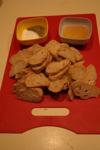 Oil, herbs, and day-old bread are the ingredients of homemade crostini
