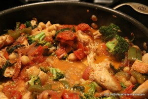 Italian chicken stew simmering on the stove