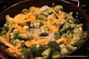 Stir fry peppers, broccoli, zucchini, and onions for this Spicy Broccoli Stir-fry